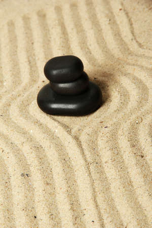 Zen garden with raked sand and round stones close up Stock Photo - 20012449