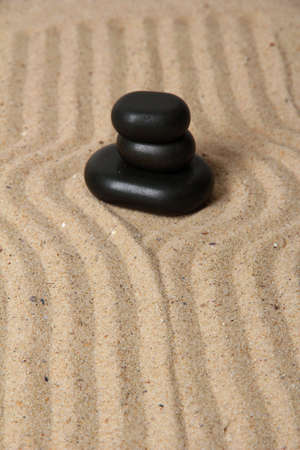 Zen garden with raked sand and round stones close up Stock Photo - 20012640