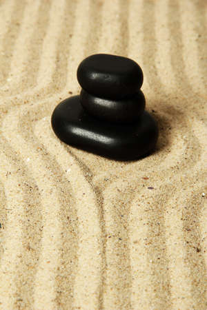 Zen garden with raked sand and round stones close up Stock Photo - 20012567