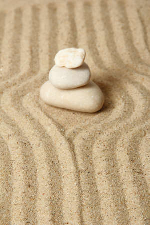 Zen garden with raked sand and round stones close up Stock Photo - 20012639