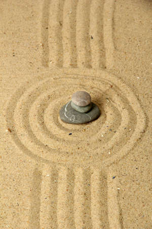 Zen garden with raked sand and round stones close up Stock Photo - 20012690