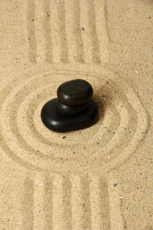 Zen garden with raked sand and round stones close up Stock Photo - 20012675