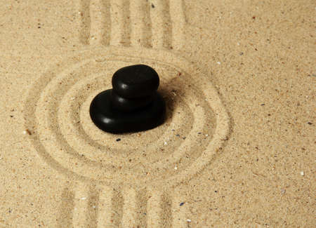 Zen garden with raked sand and round stones close up Stock Photo - 20012667