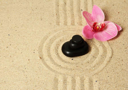 Zen garden with raked sand and round stones close up Stock Photo - 20012638