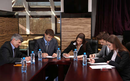 signing contract: Business people working in conference room