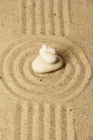 Zen garden with raked sand and round stones close up Stock Photo - 20027897