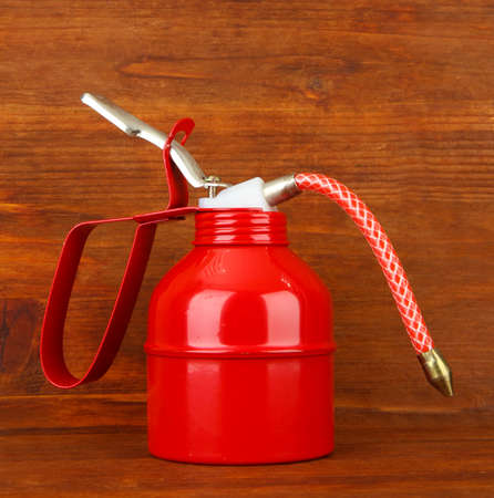 Oil can on wooden background Stock Photo - 20078751