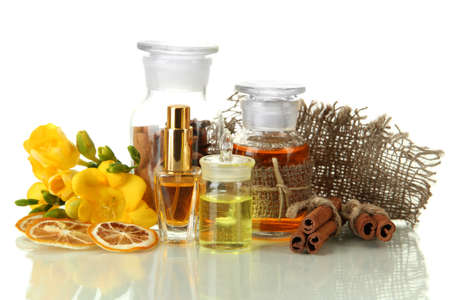 Bottles with ingredients for the perfume, isolated on white photo