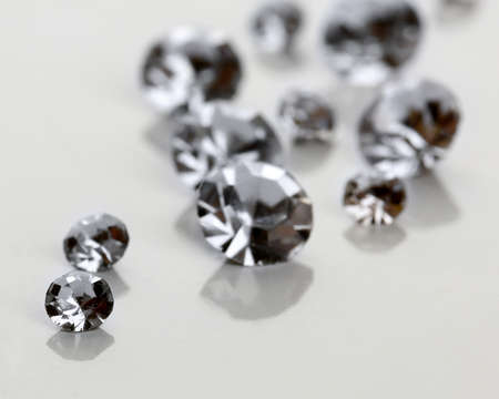 Beautiful shining crystals (diamonds), isolated on white photo