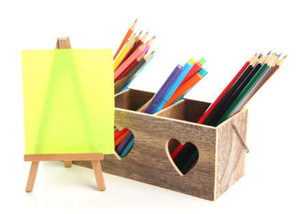 Different pencils in wooden crate and easel, isolated on white Stock Photo - 20078682