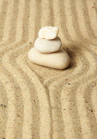 Zen garden with raked sand and round stones close up Stock Photo - 20079490