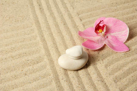 Zen garden with raked sand and round stones close up photo