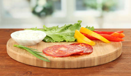 Ingredients for preparing salami rolls, on bright background Stock Photo - 20068055