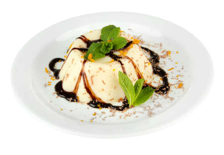 Panna Cotta with chocolate sauce, isolated on white photo