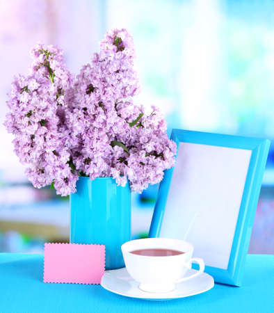 Beautiful lilac flowers on table in room Stock Photo - 20084783