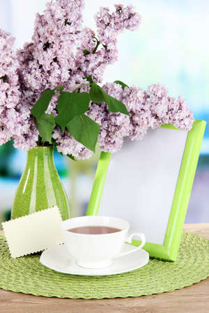 Beautiful lilac flowers on table in room photo