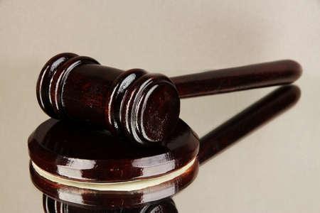 Wooden gavel on grey background