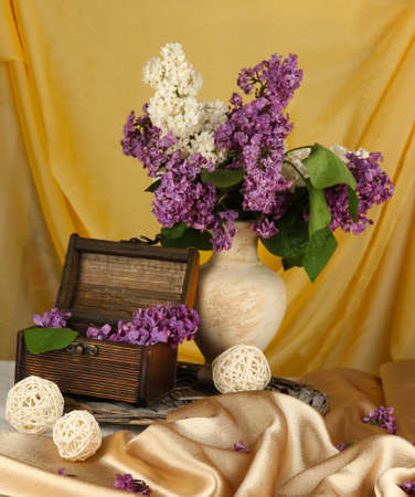 Composition with lilacs on bright background photo