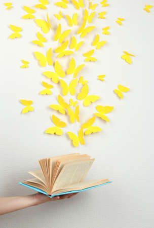 amorousness: Paper yellow butterflies fly out of book Stock Photo