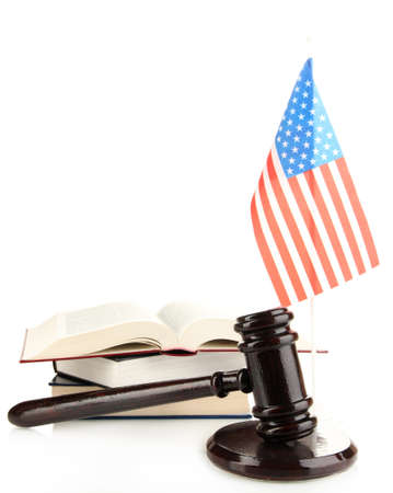 Wooden gavel, books and American flag isolated on white photo