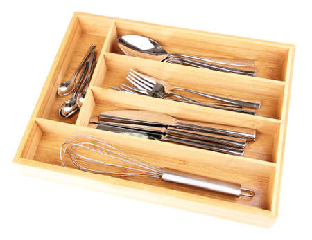 Wooden cutlery box with checked cutlery isolated on white photo