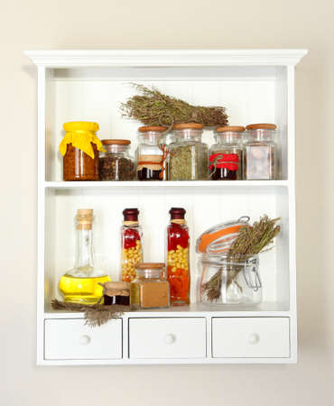 Variety spices on kitchen shelves photo