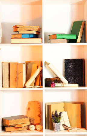 Many books on white  shelves photo