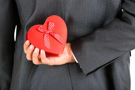 Young businessman present gift box, close up photo