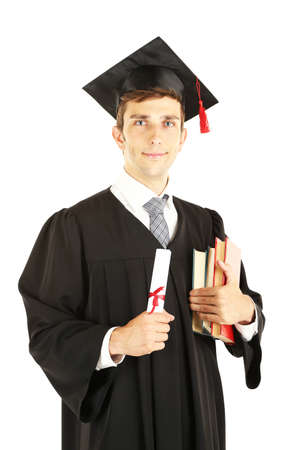 college graduation: Young graduation man holding diploma and books, isolated on white