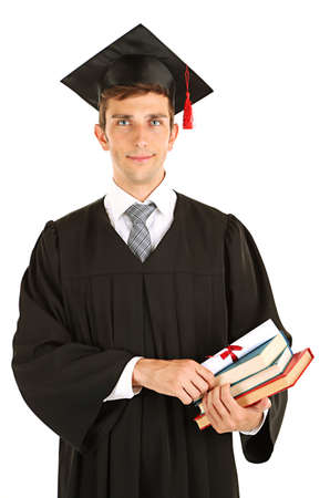 Young graduation man holding diploma and books, isolated on white photo