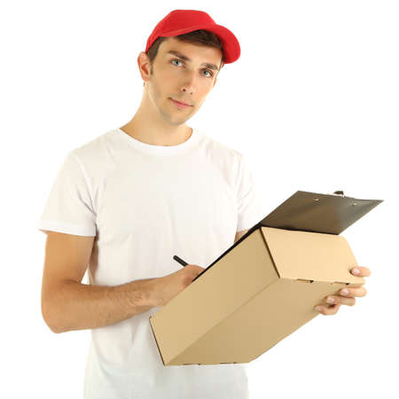 Young delivery man holding parcel and clipboard, isolated on white photo