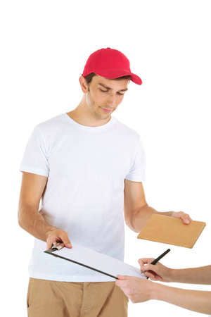 Young delivery man giving parcel, isolated on white photo