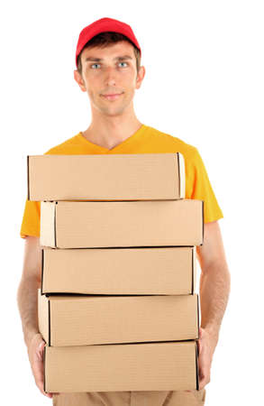Young delivery man holding parcels, isolated on white photo