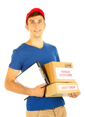 Young delivery man holding parcels and clipboard, isolated on white photo