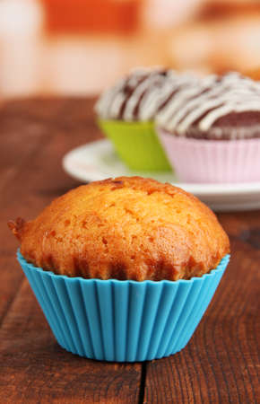bakeware: Sweet cupcakes on wooden table