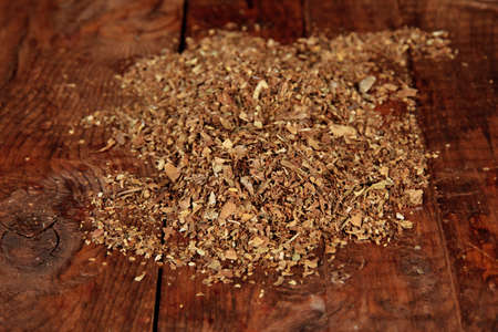 Tobacco on wooden background photo