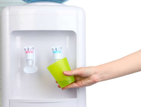 Woman filling cup at water cooler photo