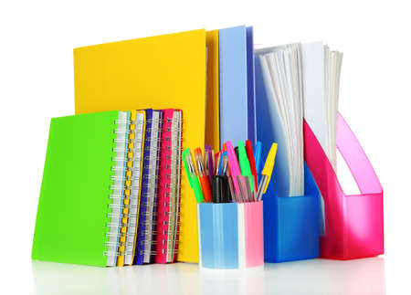 Bright office folders and different stationery isolated on white photo