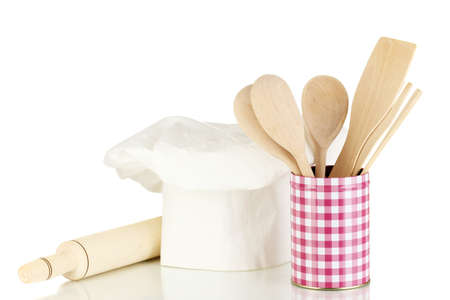 battledore: Chefs hat with spoons and battledore isolated on white Stock Photo