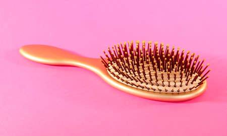 Hairbrush isolated on white photo