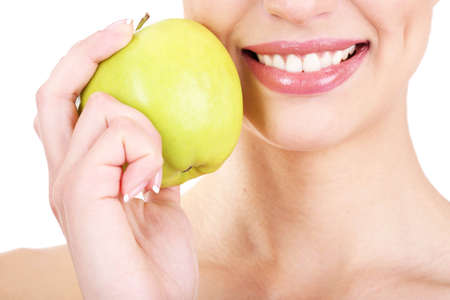 Smiling woman with apple close up photo