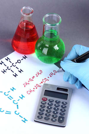 Hand scientist writing formulas photo