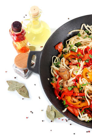 wok: Noodles with vegetables on wok isolated on white