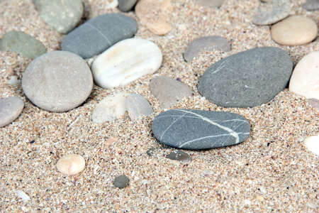 Sea stones on sand background photo