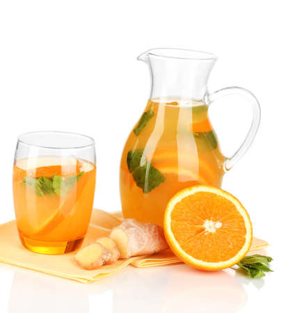 Orange lemonade in pitcher and glass isolated on white Stock Photo - 20257642
