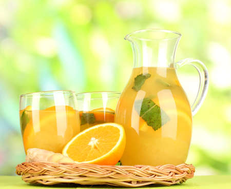 Orange lemonade in pitcher and glasses on wooden table on natural background Stock Photo - 20257765
