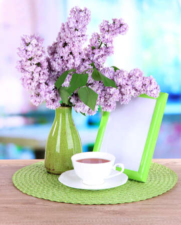 Beautiful lilac flowers on table in room Stock Photo - 20257589