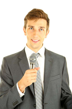 Young businessman talking with microphone, isolated on white Stock Photo - 20281225