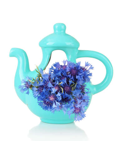 Beautiful bouquet of cornflowers in vase-teapot, isolated on white photo