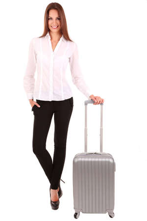 depart: Young businesswoman with suitcase isolated on white